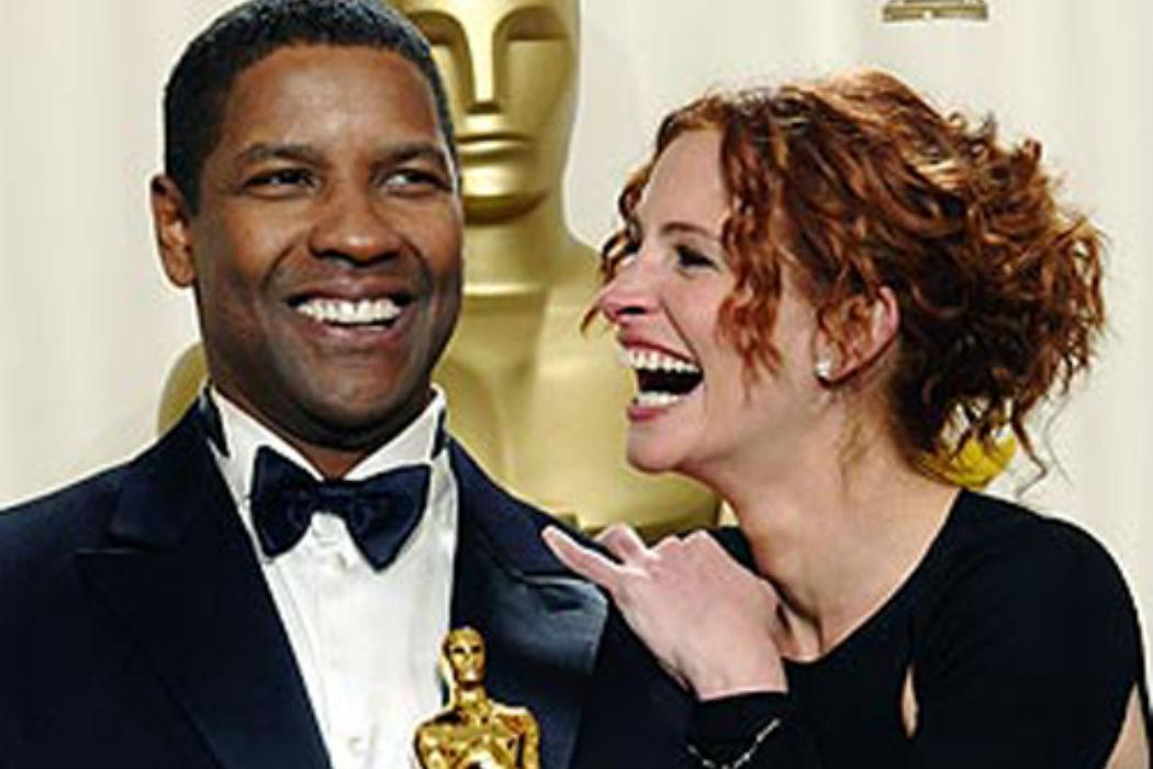 Julia Roberts se abalanza sobre Denzel Washington