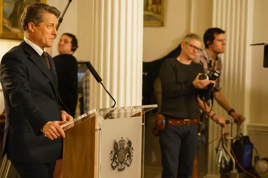Hugh Grant como David